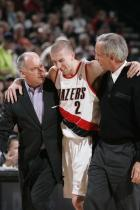 Steve Blake is helped off the floor.jpg