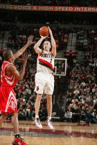 Steve Blake shoots over Luther Head.jpg