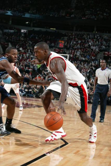 Webster drives against CJ Miles.jpg