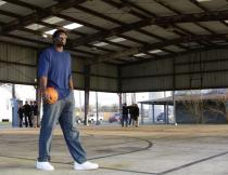 Greg Oden at basketball court in New Orleans to be refurbished 3.jpg