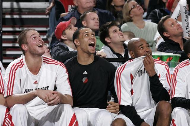 Blazers Bench reacts to a play on the jumbotron.jpg