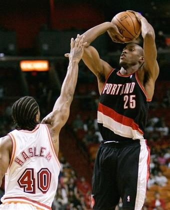 Outlaw shoots over Haslem.jpg
