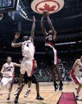 Travis Outlaw shoots over Bosh.jpg