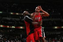 Jarrett Jack and Martell Webster celebrates double OT win in Chicago.jpg