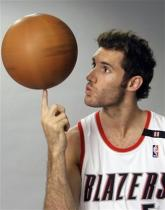 Rudy Fernandez spins the basketball on his finger tip.jpg