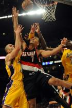 Brandon Roy is mugged by the Lakers in the paint.jpg