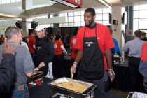 Greg Oden helps serve at the Harvest Dinner.jpg