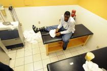 Greg Oden in the treatment room with a sprained foot.jpg
