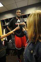 Greg Oden is interviewed in the locker room before the game.jpg