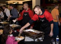 Sergio Rodriguez helps serve at the Harvest Dinner.jpg