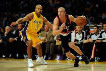 Steve Blake drives the baseline against Derek Fisher.jpg