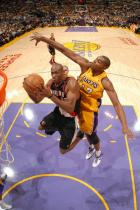 Travis Outlaw double clutches inside against Andrew Bynum.jpg