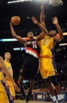 Travis Outlaw goes in strong against Andrew Bynum.jpg