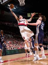 Rudy Fernandez swoops in for a layup in a Blazers jersey.jpg