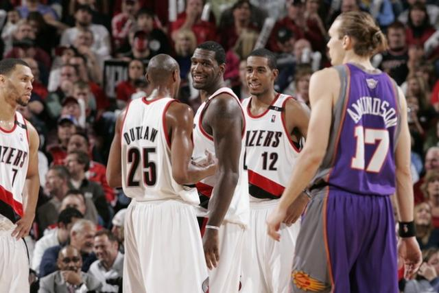 Greg Oden smiles with teammates alongside.jpg