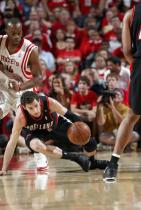Rudy Fernandez goes down low to get the ball against Houston.jpg