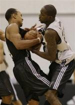 Jerryd Bayless fights for the ball during summer league 2009.jpg