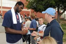 Greg Oden signs autographs after practice for team USA.jpg