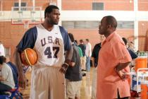 Greg Oden talks to Nate McMillen during the team USA mini camp.jpg