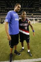 LaMarcus Aldridge takes a photo with Didier Drogba.jpg