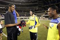 LaMarcus Aldridge smiles talking to Petr Cech and Didier Drogba.jpg