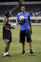 LaMarcus Aldridge holds a soccer ball next to Didier Drogba.jpg