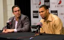 Brandon Roy speaks on the microphone next to Kevin Pritchard.JPG