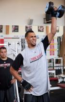 Brandon Roy lifts up a heavy dumbell.JPG