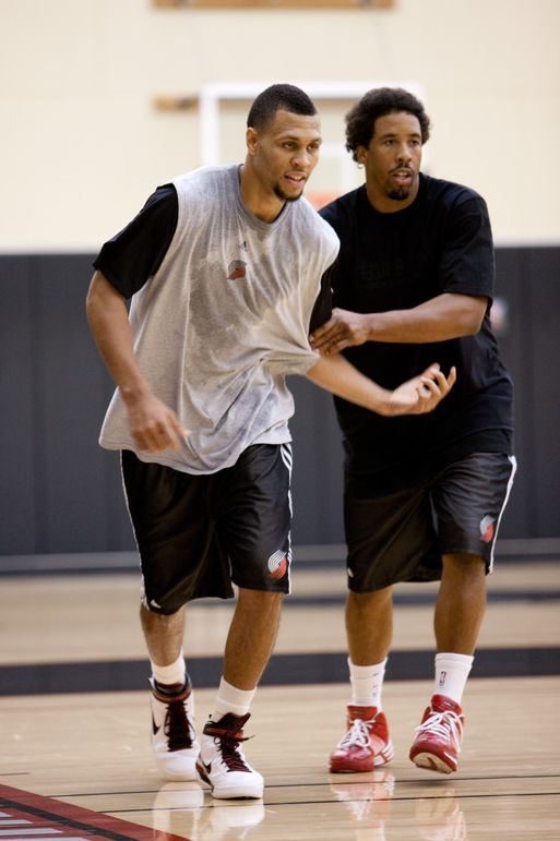 Brandon Roy and Andre Miller during practice.JPG