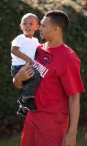 Brandon Roy carries his son.JPG