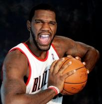 Greg Oden picture of him grabbing the ball with both hands 2009.JPG