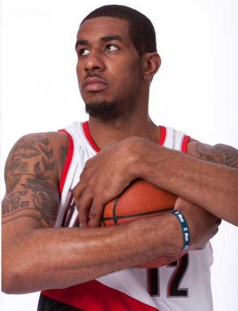 LaMarcus Aldridge photo of him clutching the basketball.JPG