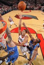 Brandon Roy shoots over the Birdman during the 2009 Preseason.JPG
