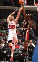 Greg Oden blocks Chris Kaman's of the Clippers' shot.JPG