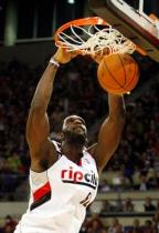 Greg Oden dunks in a Rip City jersey.JPG