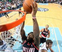 Greg Oden goes for the two handed dunk inside against the Jazz.JPG