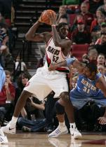 Greg Oden posts up Nene during the 2009 Preseason.JPG