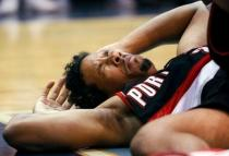 Andre Miller winces in pain after hitting the floor.JPG