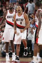Juwan Howard is pumped as his Blazer teammates look on.JPG