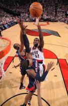 Greg Oden shoots a jump hook in the lane against the Hawks.JPG