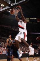 Greg Oden two handed power dunk against the Rockets.JPG