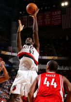 Greg Oden shoots in the lane against the Rockets.JPG