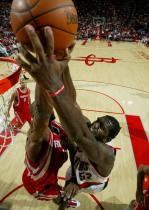 Greg Oden tries to dunk over Carl Landry.JPG