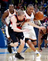 Steve Blake gets in Russell Westbrook's way.JPG