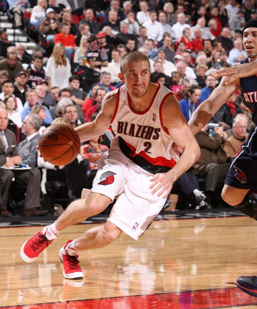Steve Blake drives past Mike Bibby.JPG