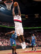 Greg Oden elevates for the two handed dunk against the TWolves.JPG
