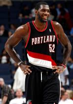 Greg Oden smiles in a Trail Blazer road jersey.JPG