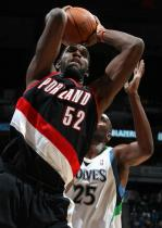 Greg Oden secures a rebound with both hands against the Timberwolves.JPG