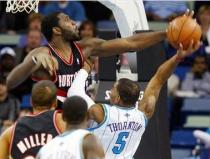 Greg Oden blocks Marcus Thornton's shot.JPG