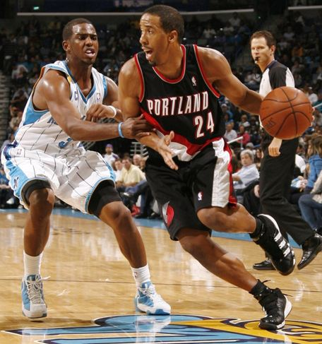 Andre Miller drives past Chris Paul.JPG